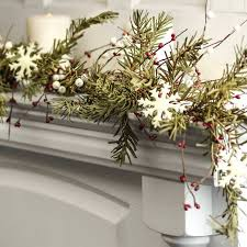 primitive artificial pine and snowflake garland florals