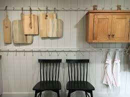 shaker style peg racks in a guest home kitchen stone house