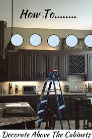 Area Above Kitchen Cabinets by What To Do With The Space Above Your Kitchen Cabinets Home
