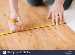 up of measuring wood flooring stock photo