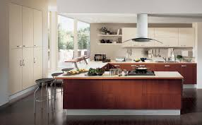 kitchen cabinets hanging lights over a kitchen island counter and