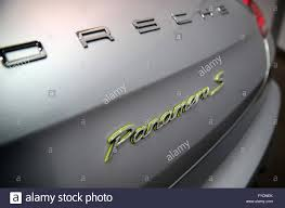 Porsche Panamera S E Hybrid - a green panamera s logo on a porsche panamera s e hybrid during an
