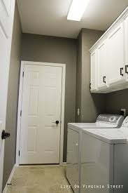 laundry room upper cabinets laundry room cabinet with ge washing machine also laundry hanging