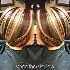 brunette hairstyle with lots of hilights for over 50 chunky blonde and red highlights with s dark brown base on a short
