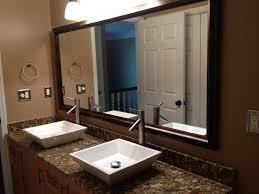 guest bathroom vanity with white vessel sinks on granite
