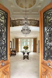Entry Foyer Lighting Ideas by Luxury Entryway Decors With Glass Chandelier Over Antique Foyer