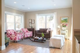 living room black and brown velvet sofa striped rug white pillow