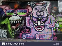 paris france graffiti mural paintings on wall outside street paris france graffiti mural paintings on wall outside street abstract design cartoon caracters