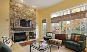 cozy living room with fireplace rectangle beige wooden laminate