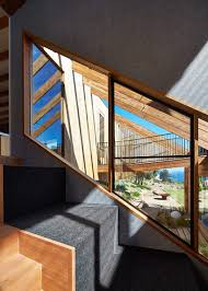 bkk architects designs split level house on offset topography