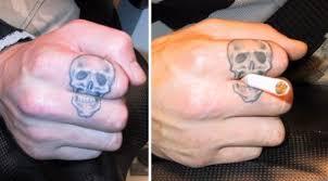sugar skulls tattoos on fingers