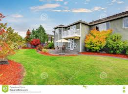 well kept backyard garden and patio area of american house stock