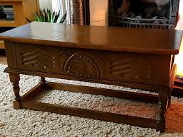 solid oak carved lift up top storage table in leicester