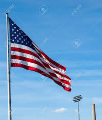 Ripped American Flag American Flag Waving Proudly On A Clear Windy Day At A Stadium