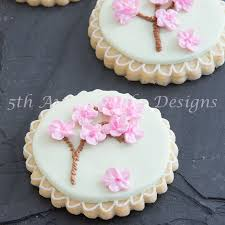 cherry blossom trees piped on a cookie 5thavenuecakedesigns