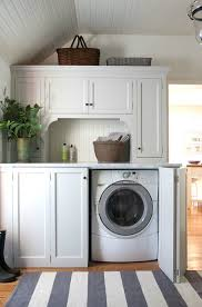 washer and dryer cabinets hidden washer and dryer cottage laundry room sage design