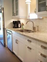 Granite Countertops And Backsplashes by Venetian Gold Light Granite With Off White Subway Tile And Off
