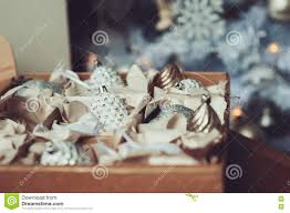 white and silver shiny stylish christmas decorations in box
