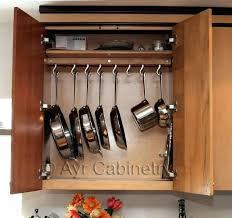 putting up kitchen cabinets up kitchen cabinets hang em up hanging pot rack inside a cabinet