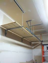 Hanging Shelves From Ceiling by Hanging Garage Shelves Eye Bolt In Ceiling Goes Through Ceiling