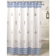 interior white and blue striped fabric ship shower curtain on