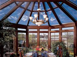 this traditional dining room is enclosed in a wood and glass