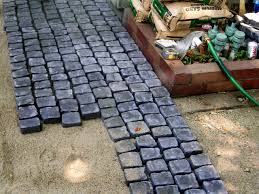 Patio Paver Base Material by How To Install A Cobblestone Patio On Concrete Or Bare Soil How