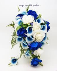 white and blue roses cascade bridal bouquet blue picasso callas white royal blue