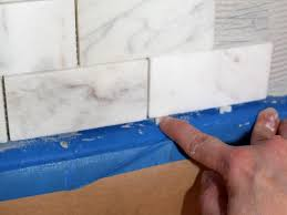 How To Do Tile Backsplash In Kitchen How To Install A Marble Tile Backsplash Hgtv