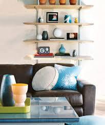 How To Organize Bookshelf 22 Ways To Arrange Your Shelves Real Simple