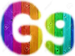 the letter g with a wooden rainbow background stock photo picture