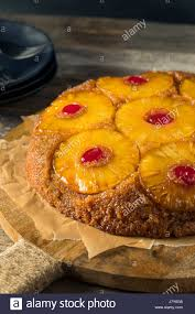 sweet homemade pineapple upside down cake with cherries stock