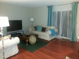 Two Different Colored Curtains Carpet Color And Accent Chair Color