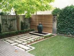 fabulous grass plan with bamboo fence for simple backyard
