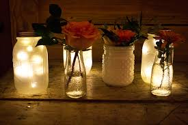 the mix of frosted led jar lights and vintage vases at