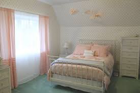 white interior design idea for bedroom using pastel bedding