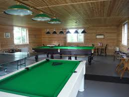fantastic games room with table tennis pool snooker darts