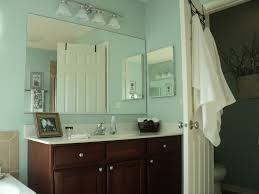 best blue and brown bathroom ideas pictures rummel rummel blue blue wall paint dark brown real wood vanity with storage drawers mirror without frame white granite