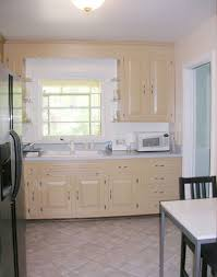 How To Refinish Kitchen Cabinets With Paint Painting Your Kitchen Cabinets Is Easy Just Follow Our Step By