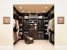 modern mirror closet model and white master with wooden side table