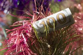 new year dollar bill a hundred dollar bill collapsed with a straw is on the branches of