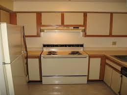 Painting Over Laminate Kitchen Cabinets Refinish Laminate Cabinets Before And After