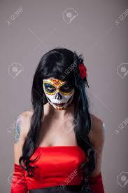 Sugar Skull Halloween Makeup Young Woman With Sugar Skull Halloween Make Up Wearing Red Dress