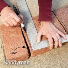How To Cut Patio Pavers Without A Saw Use Brick Borders For Path Edging Family Handyman