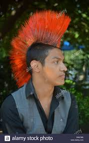 young man with a colorful mohawk haircut at union square park in