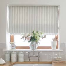 country blind inspiration sea ivory cambridge stripe blinds creating the perfect laid back kitchen perfect with ivory pom pom trim