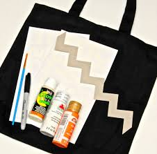 halloween trick or treat bag with handprint ghosts