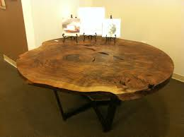 this is a stunning black walnut and gun metal steel table made