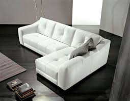 l shaped white leather living room couch with tufted seat and