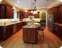 Kitchen Cherry Cabinets Kitchen With Cherry Cabinets Granite Counter Tops And Red Oak